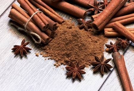 anice: anice and cinnamon, on wooden table Stock Photo