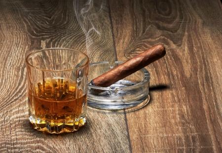drunks: Whiskey and Cigar on black background