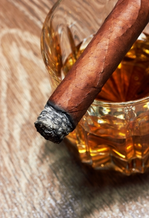 Whiskey and Cigar on black background photo
