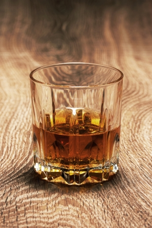 whiskey in glasses on wooden table photo
