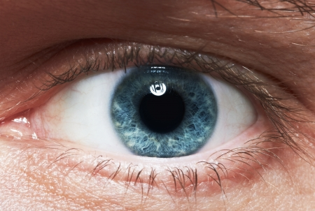 Close-up picture of blue eyes from a man