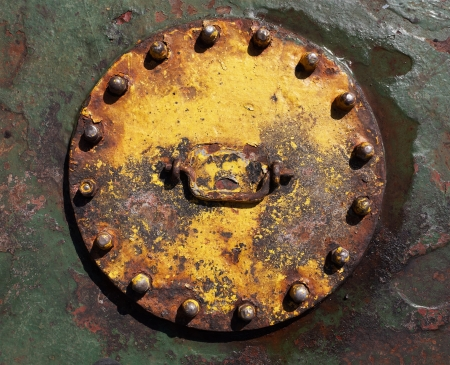 solidity: Industrial abstract background texture with cover with bolts Stock Photo