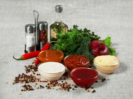 Assortment of sauces and spices photo