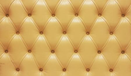 biege: Biege genuine leather upholstery, closeup.
