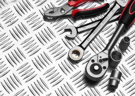 Many Tools on metal background photo