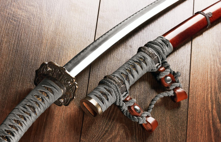 tsuka: Katana, japanese sword, on wood background Stock Photo