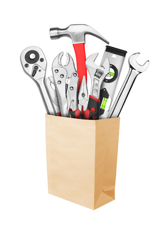 toolkit: Many Tools in paper bag, isolated on white background Stock Photo