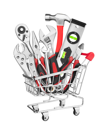 Many Tools in shopping cart, isolated on white background photo