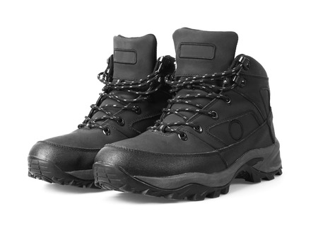 hiking shoes: Mans winter boots of black color, isolated on white background