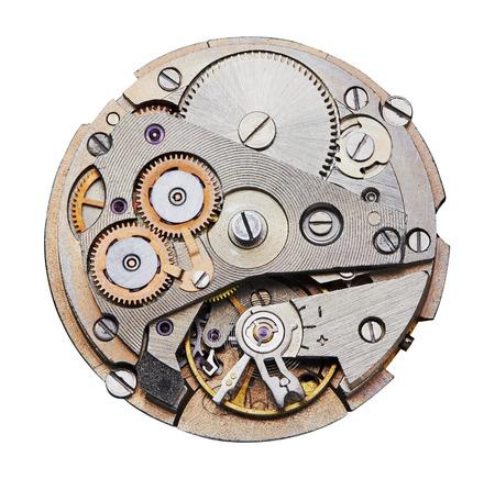 engranes: Mecanismo del reloj con engranajes, primer plano. Aislado en blanco. Foto de archivo