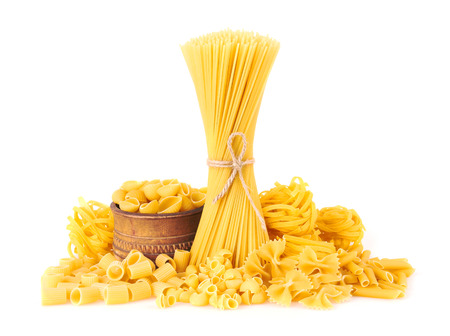 Mix of pasta, isolated on white background Foto de archivo