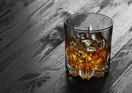 shooter drink: Whiskey in glasses on wooden table