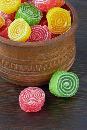 jellybean: Sweet colorful candy on wooden background