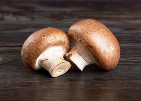 Champignon Mushroom on wood background Zdjęcie Seryjne