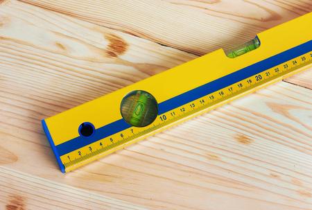 millimetre: Construction Level on wooden background