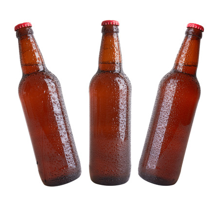 beer bottle: Bottles with drops isolated on white background
