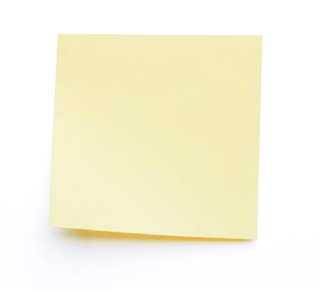 Gele stok nota geïsoleerd op een witte achtergrond