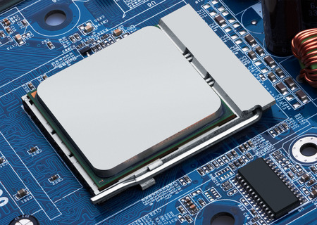processor: Electronic circuit board with processor, close up.