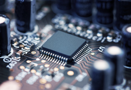 circuitry: Electronic circuit board with processor, close up.
