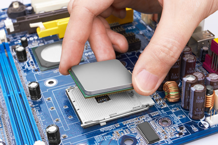 Electronic circuit board, processor installation, close up. Stock Photo