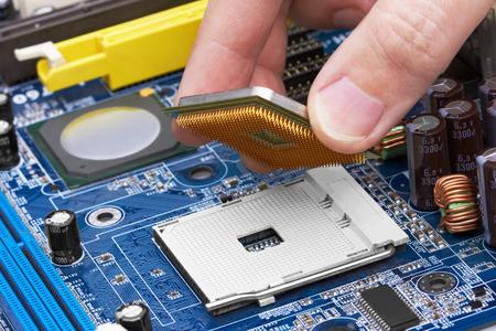 processor: Electronic circuit board, processor installation, close up. Stock Photo