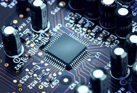 background information: Electronic circuit board with processor, close up.