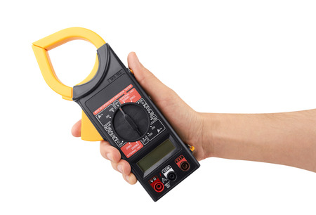 impedance: Digital multimeter in hand isolated on white background Stock Photo