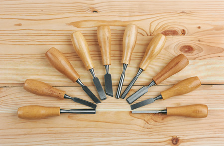sculp: Set of Chisels on wooden background Stock Photo