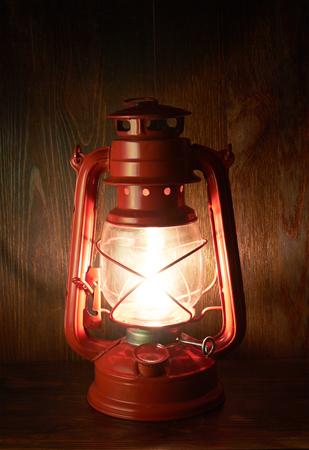 kerosene: Lantern kerosene oil lamp, on wooden background