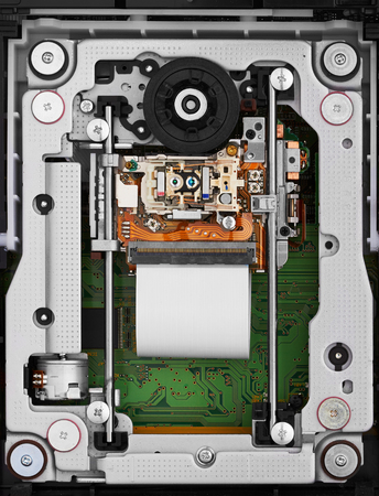 mechanism: Objective lens and spindle assembly of a computer cd-rom drive, closeup