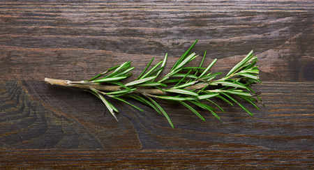 Fresh rosemary bound on a wooden board