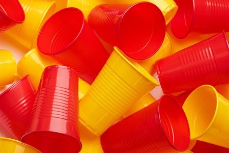 Plastic colored cup close-up - Environmental problem concept