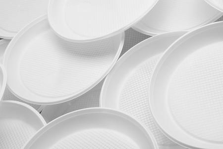 White plastic plates close-up - Environmental problem concept Stok Fotoğraf