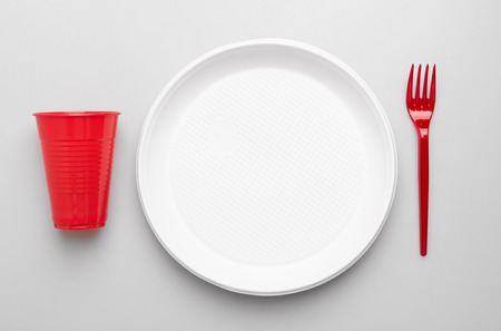 Plastic plate, forks and cup on white background - Environmental problem concept Stok Fotoğraf