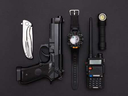 Weapons and military equipment on black background