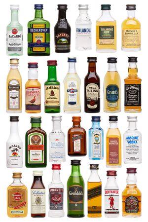 Set of bottles of assorted alcoholic beverages, isolated on white Editöryel