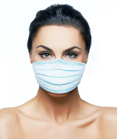 European young woman in a protection mask, for a prevention from covid-19 virus