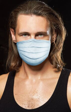 Young man in a protection mask, for a prevention from covid-19 virus Standard-Bild