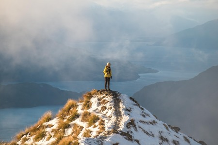 roy: person hiking on snow at Roy peaks over Lake Wanaka, New Zealand