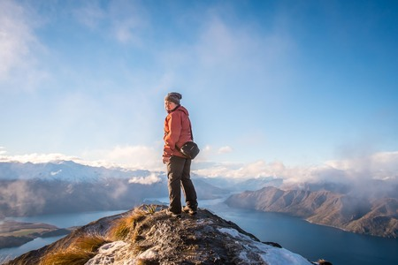 roy: person at top of Roys peak ,wanaka in new zealand