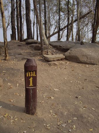 kilometre: Milestone at the first kilometre in ascent to the top of Phukradueng national park, Thailand Stock Photo