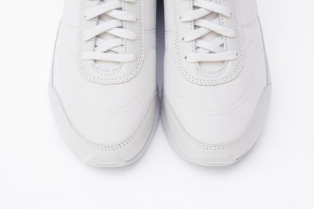 A pair of white running shoes photo