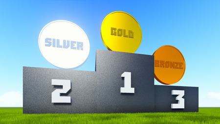 rostrum: Victory rostrum on the green grass with a golden, silver and bronze medals on top  Stock Photo