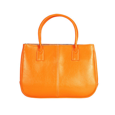 vanity bag: High-resolution image of an isolated orange leather handbag on white background. High-quality clipping path included.