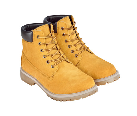 steel toe boots: Yellow leather boots isolated on white background w clipping path
