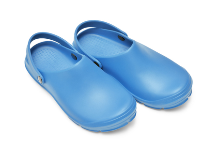 Crocs shoes. A pair of blue clogs isolated on white background w path