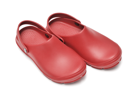 Crocs shoes. A pair of red clogs isolated on white background w path
