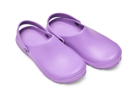 Crocs shoes. A pair of purple clogs isolated on white background w path