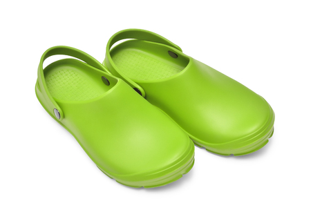 Crocs shoes. A pair of green clogs isolated on white background w path