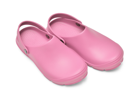 Crocs shoes. A pair of pink clogs isolated on white background w path Stock Photo
